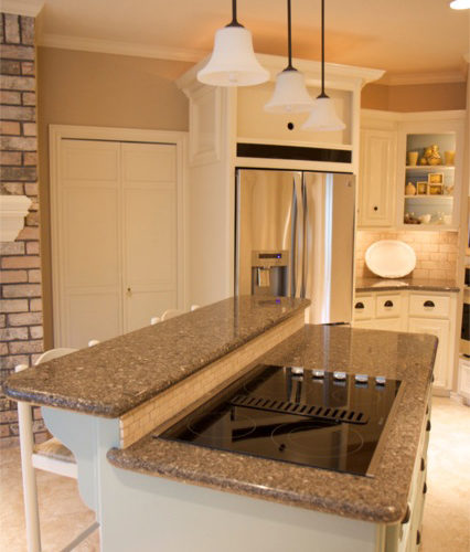 Sherwin Williams Nomadic Desert SW 6107 Kitchen with stainless steel appliances