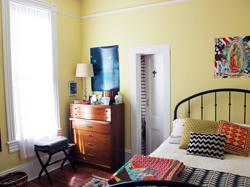 Optimistic Yellow used in a bedroom. Photo from Apartment Therapy and by Tamara Gavin.