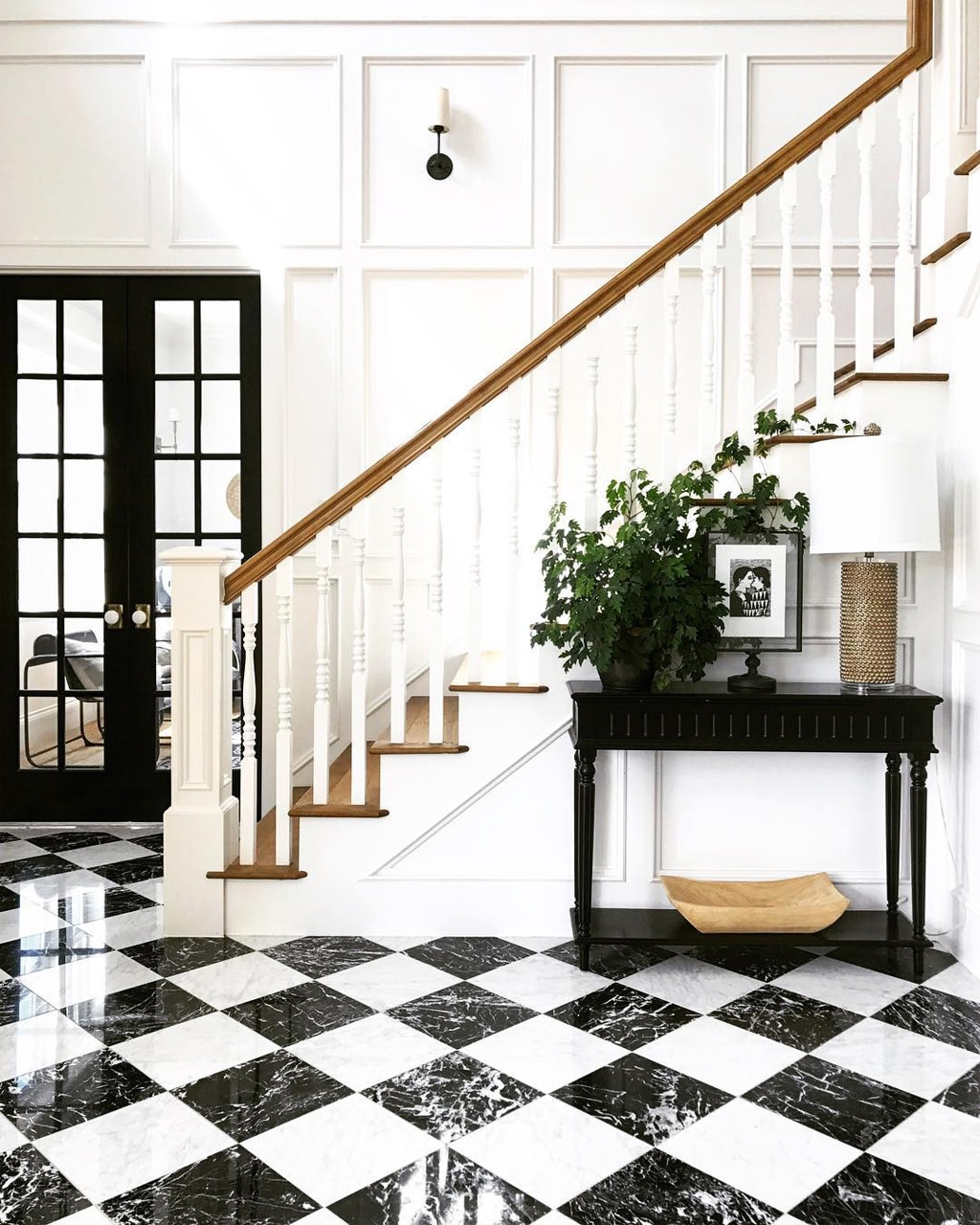 Black marble floors bring elegance and sophistication