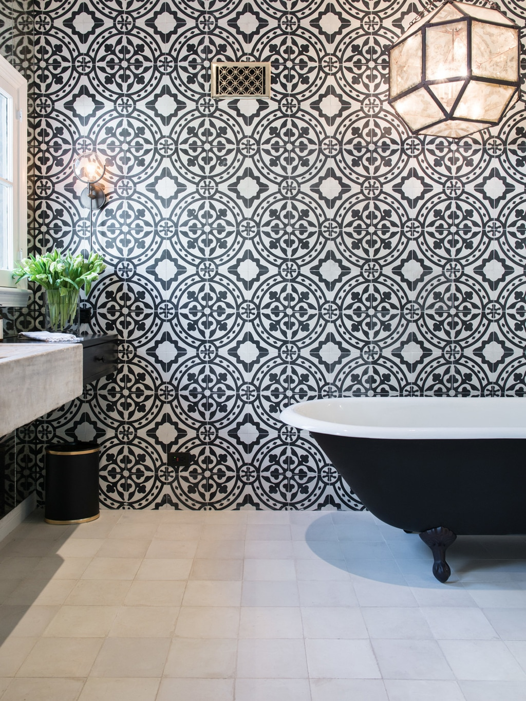 Black walls with black tub.