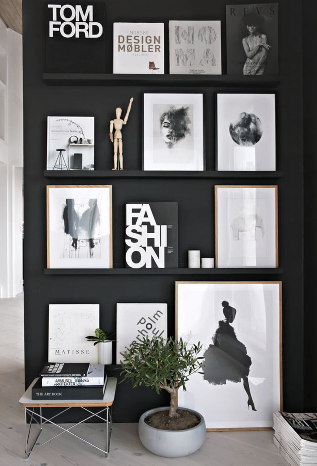 Black wall with black artwork.