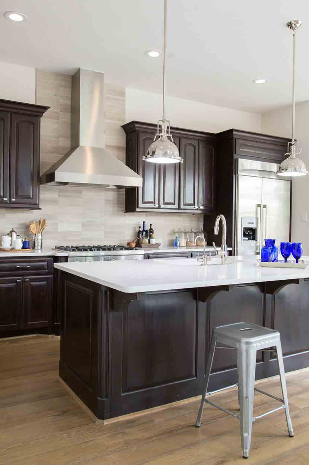 Espresso kitchen cabinets with greige wall color by Carla ...