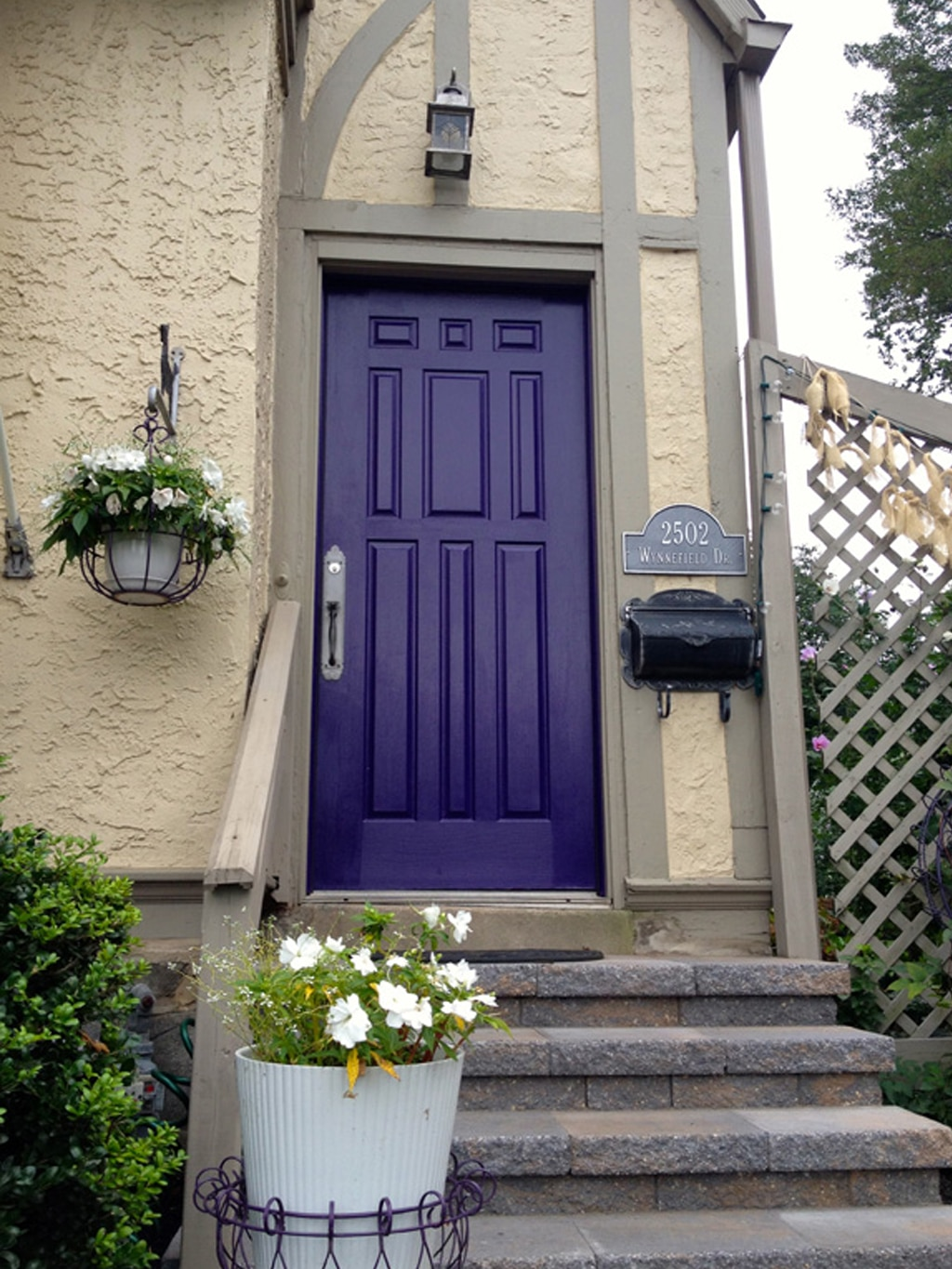 Dewberry for a front door color from The Pink Chalkboard blog