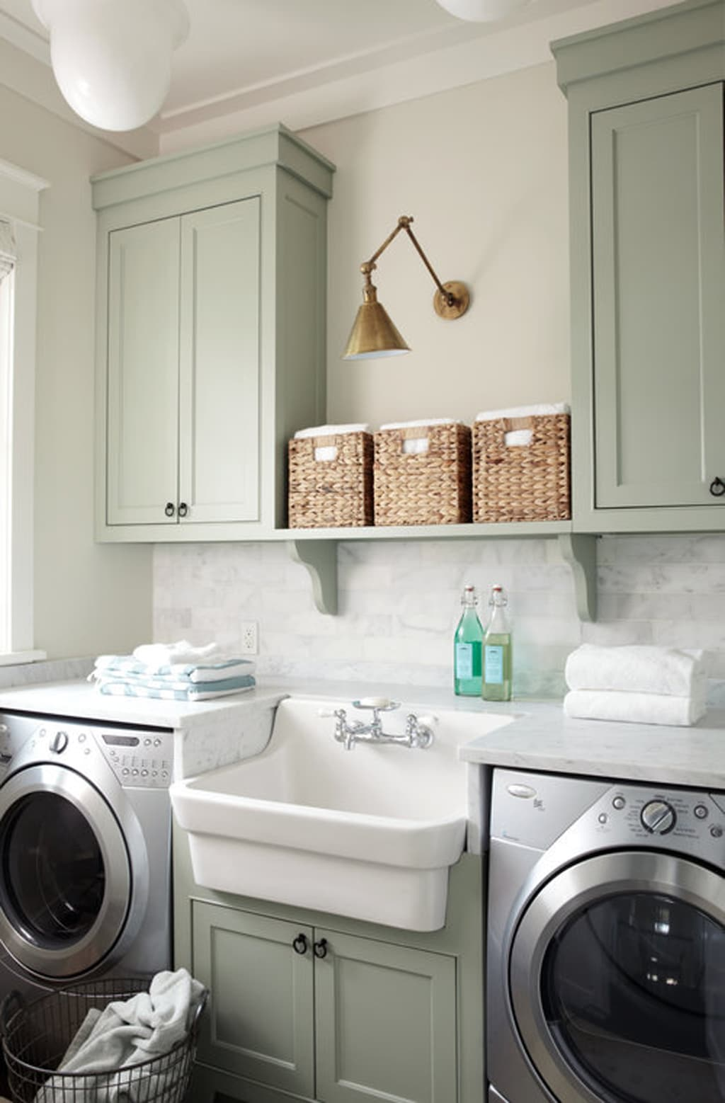 Laundry room with Oyster Bay as the cabinet color by Urban Grace Interiors
