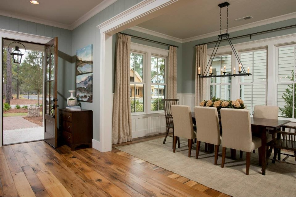 Bay in an entry and dining room open layout by Palmetto Bluff. Interior finishes by Shoreline Construction & Development. Furnishings by J. Banks Design. | Lighting by Hagemeyer