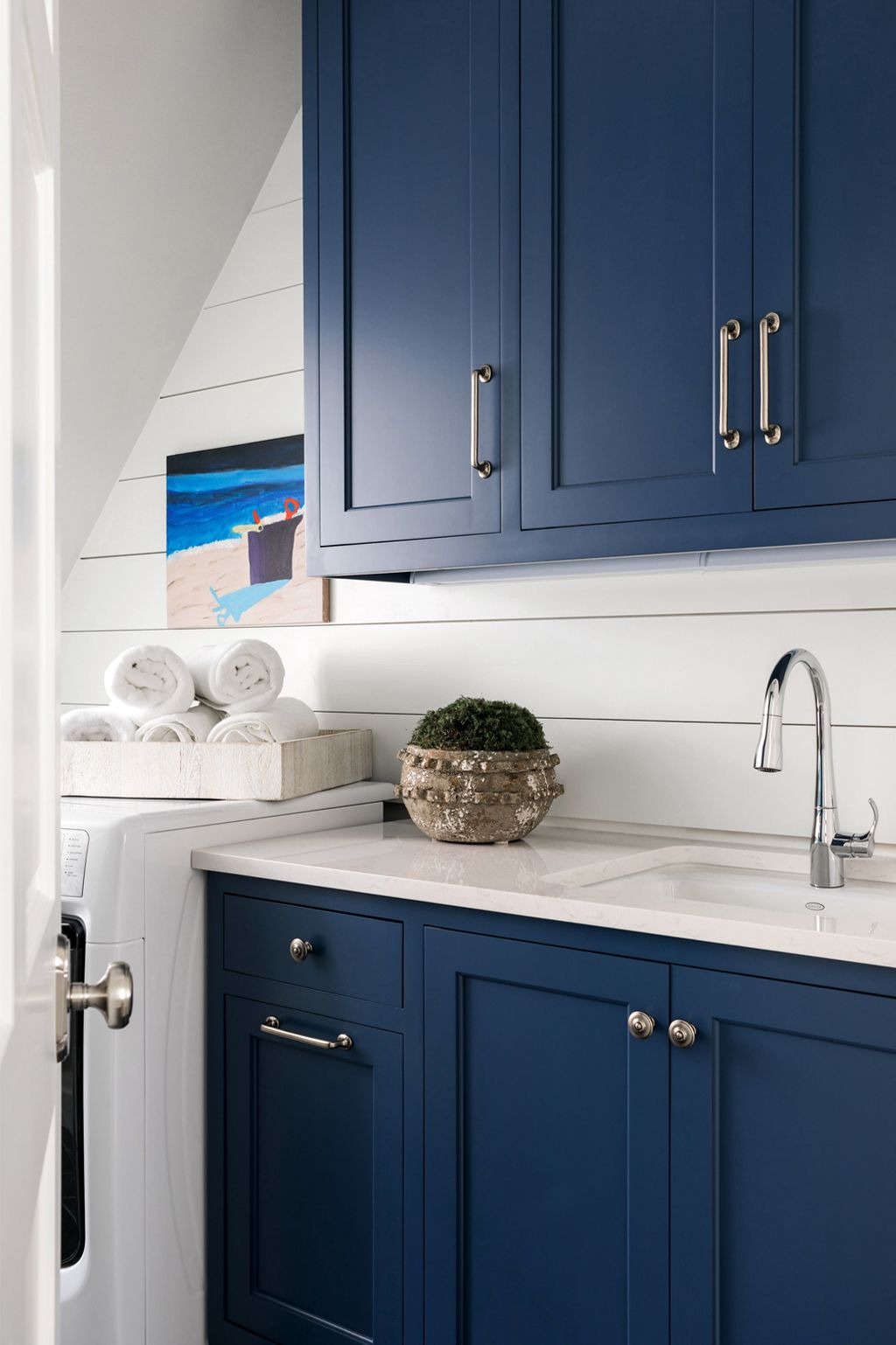 Naval on laundry room cabinets by Sherry Hart Interior Design