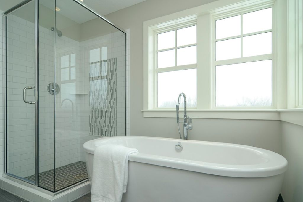 Worldly Gray bathroom walls by Boyer Building Corporation