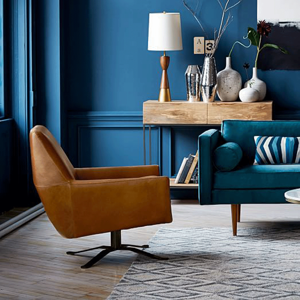 West Elm living room with teal wall and copper colored chairs