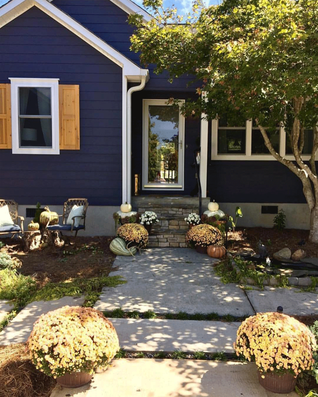 Charcoal Blue exterior by The Evergreen Maison