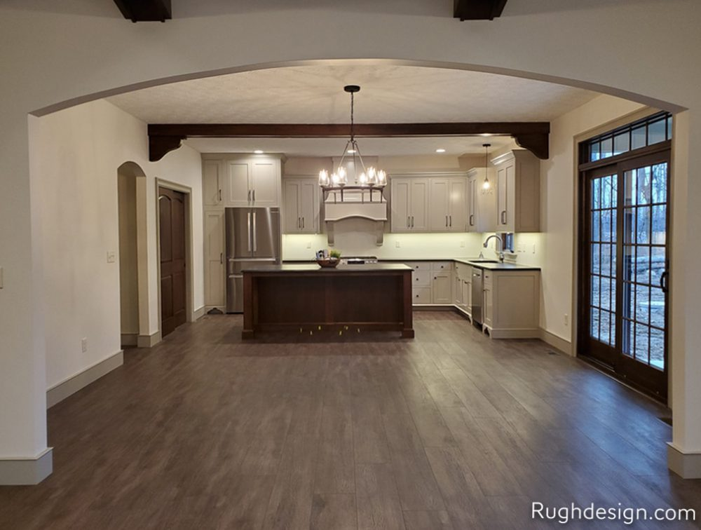 Open layout kitchen with Amazing Gray SW 7044 cabinets and White Duck SW 7010 walls