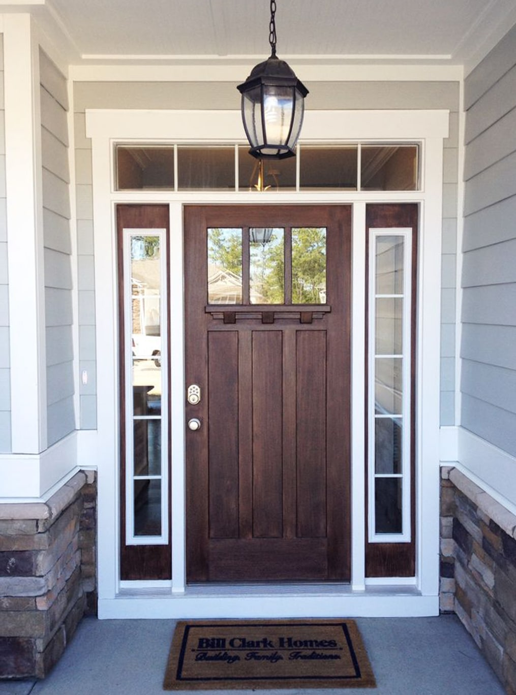 Rustic front door from Legacy Homes by Bill Clark