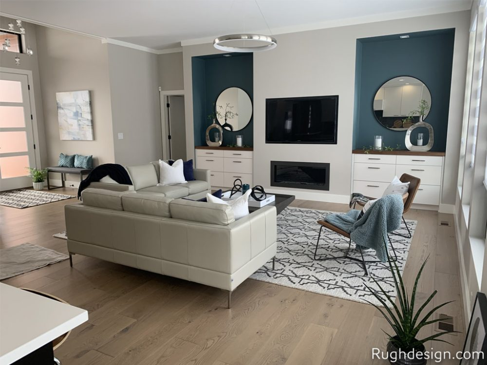 Worldly Gray SW 7043 walls with Snowbound SW 7004 trim and Riverway SW 6222 as an accent wall