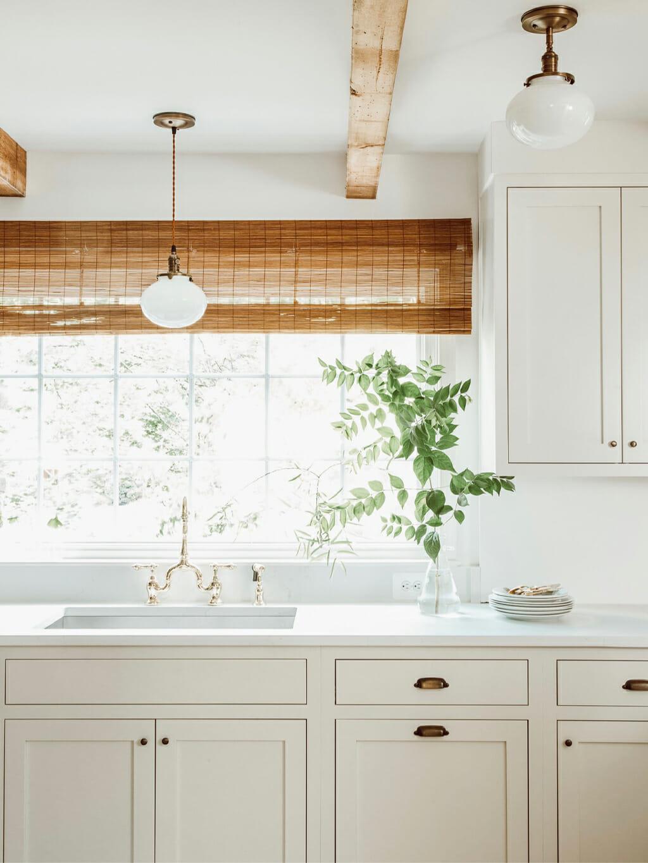Kitchen cabinets in Sherwin-Williams Shoji White SW 7042 by Lauren Liess